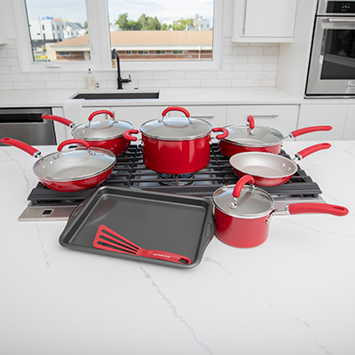 "RACHAEL RAY™ 13-pc Cookware Set - Create meals like a chef with this vibrant red shimmering cookware. This set features durable aluminum construction with stainless steel base, shatter resistant glass lids, and silicon handles. Oven safe to 400˚F and dishwasher safe.  Set includes 1.5-qt. Saucepan, 3-qt. Everything Pan, 6-qt. Stockpot, 8.5-in. Deep Frying Pan, 10.25-in. Deep Frying Pan, 3-qt. Sauté Pan, 9.625-in. Turner, and 9 x 13"" Cookie Pan."